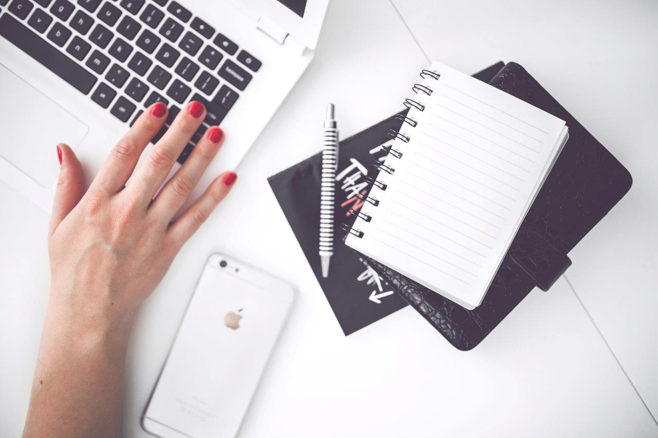 woman-hand-smartphone-desk-small